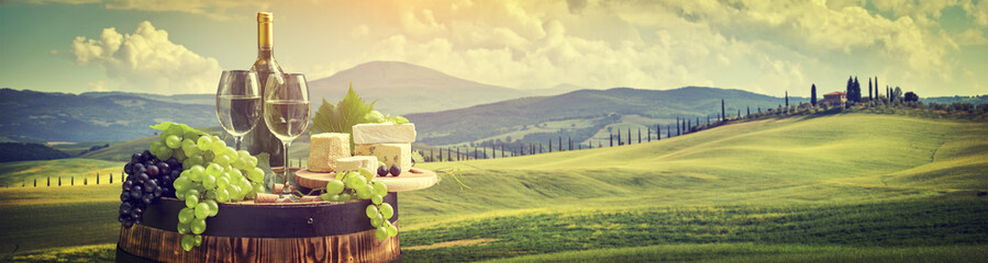 Tuinposter Wijn Red wine with barrel on vineyard in green Tuscany, Italy