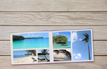 Photobook Album on Deck Table with Travel Photos Coffee or Tea in Cup