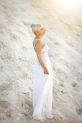 Beautiful woman on the beach. Vacation, relax and walk on the beach