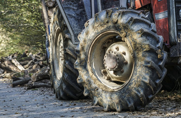 tyre of a tractor covered in mud