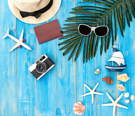 Summer Fashion woman big hat and accessories in the beach. Tropical sea.Unusual top view, colorfull background.  Summer Concept.