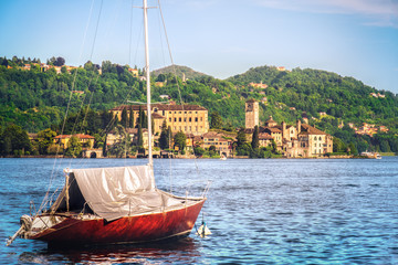 boat over italian lake orta with Orta San Giulio island on the background - Novara - Piedmont - Italy