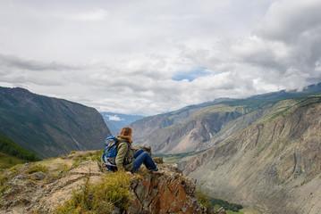 Girl, tourist, on a rock.