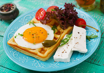 Healthy breakfast - waffles, eggs, feta cheese, tomatoes and lettuce