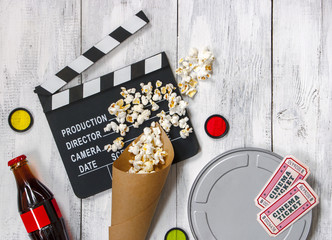 Clapperboard, movie reel and popcorn