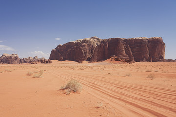 Massive stone mountain in Wadi Rum Jordan