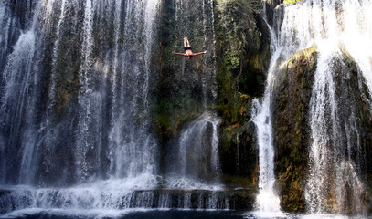 A competitor takes part in the annual international waterfall jumping competition held in the old town of Jajce