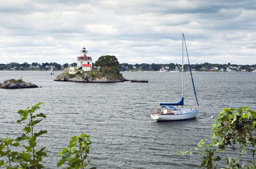 Lighthouse Guarding Sailboat in Rhode Island Harbor