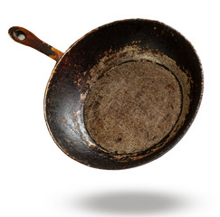 Old cast iron frying pan isolated on white background