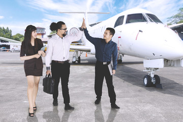 Businessman giving high five with his friends