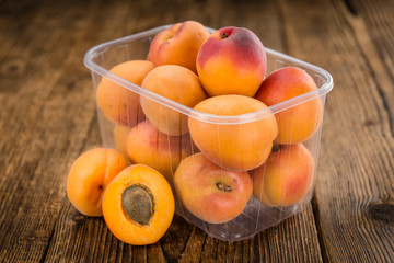 Fresh Apricots on wooden background (selective focus)