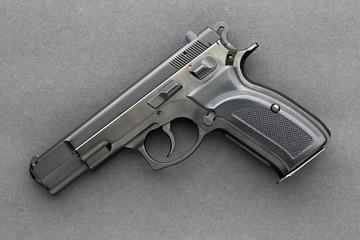 Handgun over dark background photographed from above