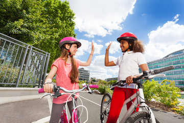 Girl friends giving high five gesture after racing