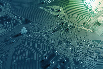 macro background of circuit board and microchip on mainboard pc desktop home use in bussiness.