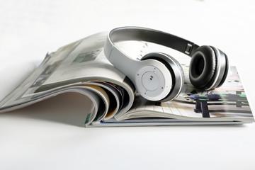 Headphones on magazine.