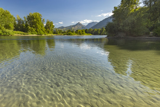 Mountains in the background of the reflective river of Wenatchee in Leavenworth Washington