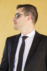 Man with suit and sunglasses