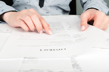 Woman reading contract terms
