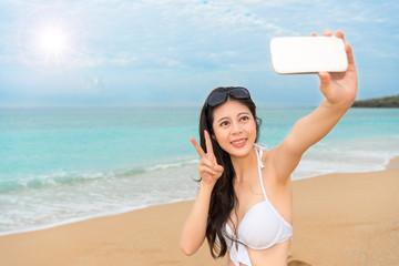bikini woman in front of the beautiful ocean