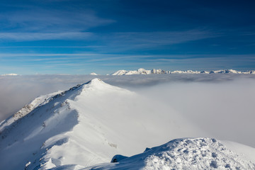 Snowcapped Mountain Ridge and Clouds
