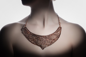 a beautiful handmade necklace on the woman's neck