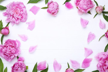 Bouquet of peony flowers on white wooden table