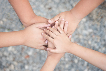 close up of many hands in circle - child  connection; teamwork together with Spirit concept.