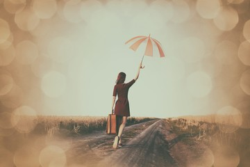 girl with suitcase and umbrella