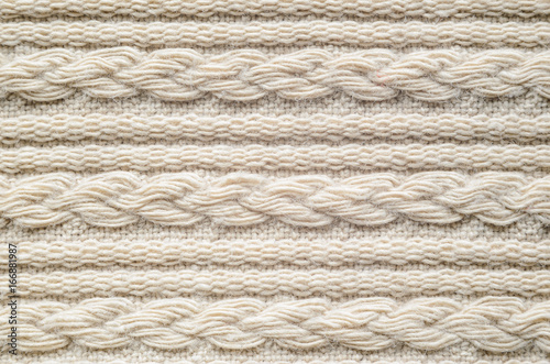 32a09d5366e49a Pigtails on Beige Knitwear Fabric Texture. Machine Knitting Texture Macro  Snapshot. Beige Knitted Background.