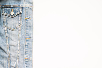 Overhead view of jeans jacket on white background with copy space,