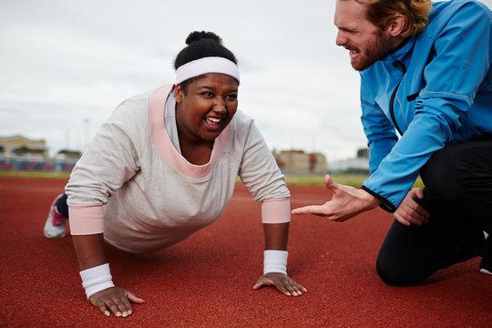 Push-up challenge during workout on stadium