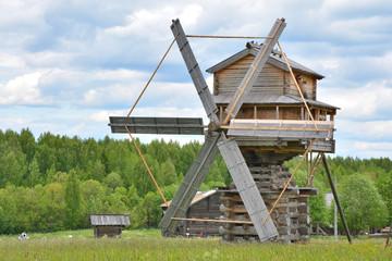 Old wooden windmill. Russia, Vologda region, village of Semenkovo, 25 Jun 2017