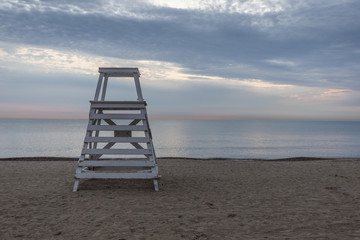 Lifeguard stand on beach with calm water