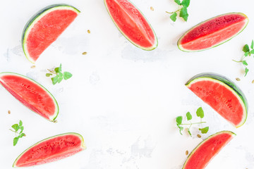 Watermelon frame. Sliced watermelon on white background. Flat lay, top view, copy space