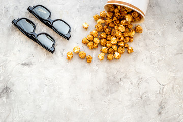 Snacks for film watching. Popcorn and soda near glasses on grey background top view copyspace