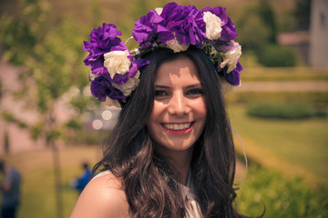 Smiling brunette woman with floral crown