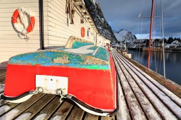 Small fishing boats ashore upon wooden pier-harbor's W.side. Hamnoy-Reine-Lofoten-Norway. 0231