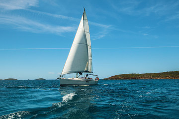 Luxery yacht Sailing on the waves in the Aegean sea.