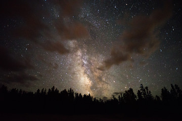 Cloudy view of the Milky Way photographed from the Rocky Mountains in Wyoming