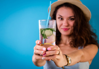 Young woman holding a glass of lemonade