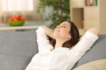 Woman relaxing alone on a couch at home