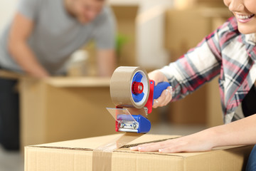 Couple moving home packing boxes