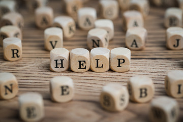 "Cubes with word ""HELP"" surrounded by many other cubes"