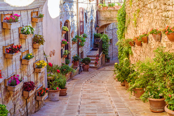 SPELLO, ITALY - MAY 27, 2017 - View of a typical alley of Spello, a medieval and beautiful town in...