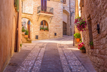 Fototapeta SPELLO, ITALY - MAY 27, 2017 - View of a typical alley of Spello, a medieval and beautiful town in Umbria.