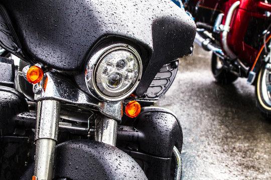 Black motorcycle. Motorcycle in the rain.