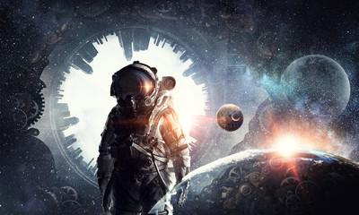 Fototapete - Astronaut explorer in space. Mixed media