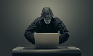 Hacker working with laptop hacking network