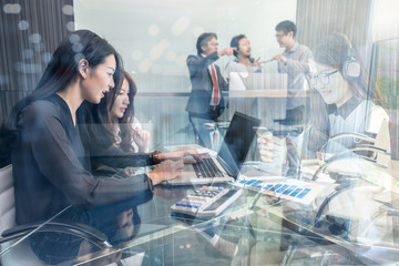 Group Of Asian and Multiethnic Business people with casual suit working and talking together in the modern Office, people business group and entrepreneurship concept.