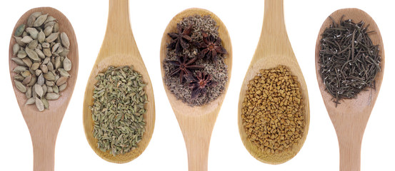 Spice seeds on bamboo spoons